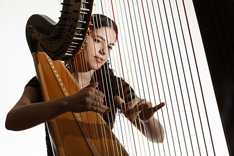 Sara Henya playing Harp